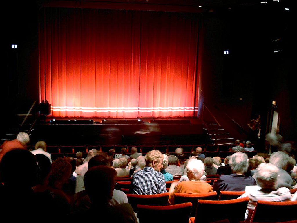 Village Theatre auditorium with audience